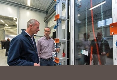 Dr. Peter Mrosik, owner and CEO of profine (left), with workshop manager Thomas Schuster at a newly installed test rig.