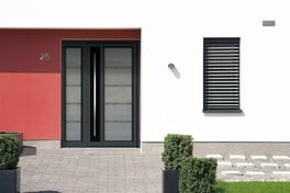 Residential door with slender side frame in anthracite grey